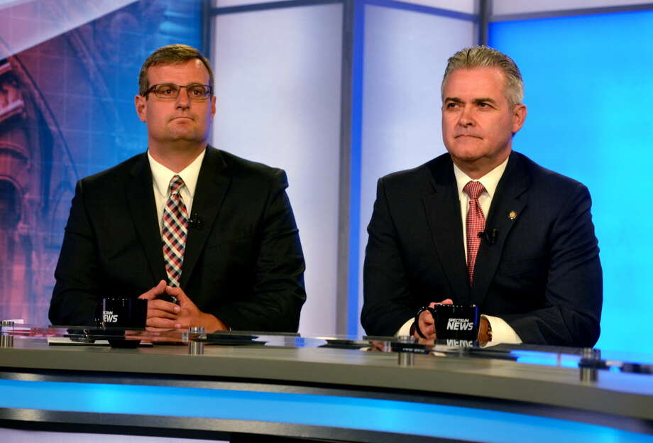 Republican candidates for Rensselaer County Executive, Chris Meyer, left, and Assemblyman Steve McLaughlin, right, take part in a debate on Thursday, Sept. 7, 2017, at Spectrum News in Albany, N.Y. (Pool photo)