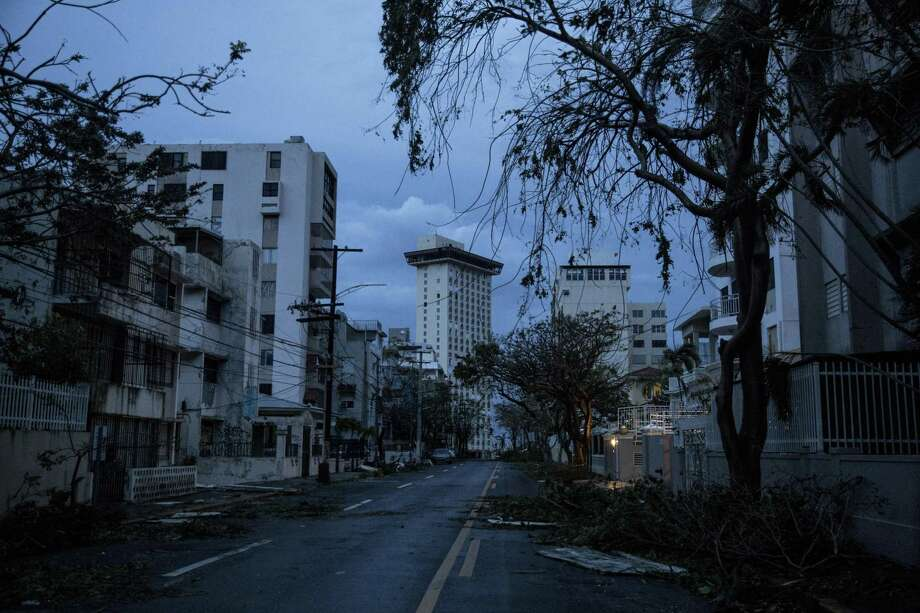 SAN JUAN, PUERTO RICO - SEPTEMBER 20: The Miramar neighborhood is completely dark during a total blackout after Hurricane Maria made landfall on September 20, 2017 in San Juan, Puerto Rico. Thousands of people have sought refuge in shelters, and electricity and phone lines have been severely effected. (Photo by Alex Wroblewski/Getty Images) Photo: Alex Wroblewski / Getty Images / 2017 Getty Images
