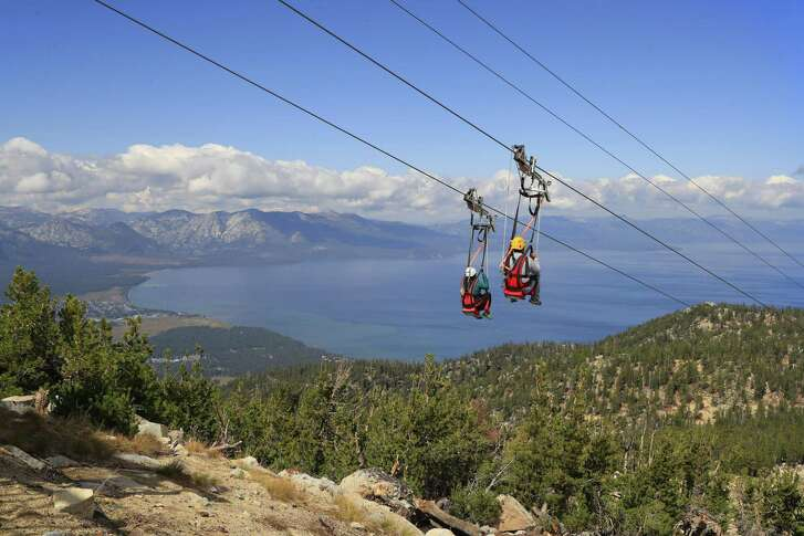 Zip line riders descend the mountain on the Blue Streak Zip Line, one of the many summer activities at the Heavenly Mountain Resort in South Lake Tahoe on Friday, September 15, 2017.