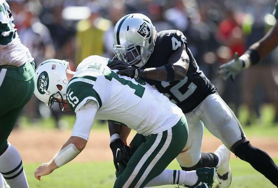 Raiders safety Karl Joseph (42) strip-sacks Jets quarterback Josh McCown, forcing a fumble, which Joseph recovered. Photo: Ezra Shaw, Getty Images