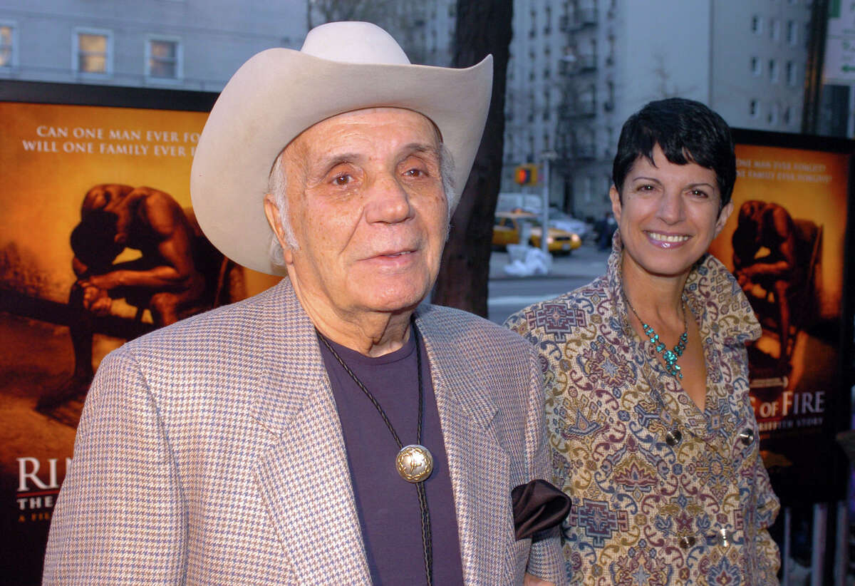 FILE - In this April 13, 2005, file photo, Jake LaMotta and his fiance Denise arrive for the world premier of the critically acclaimed boxing drama