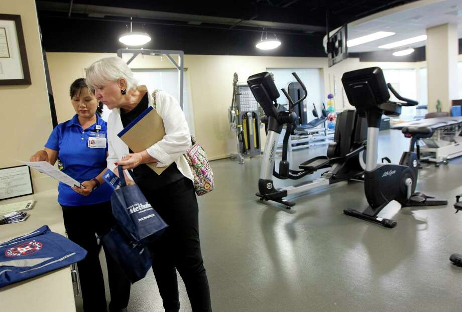 Martha Woofter, right, talks with talks with physical therapist Cathy Lansangan as she takes a tour of the new Houston Methodist Comprehensive Care Center, Wednesday, Sept. 20, 2017, in Conroe. The new facility on the Houston Methodist The Woodlands Hospital campus provides north Montgomery County residents with several services including orthopedics and sports medicine, primary care, physical therapy, imaging and rotating specialists. Photo: Jason Fochtman, Staff Photographer / © 2017 Houston Chronicle