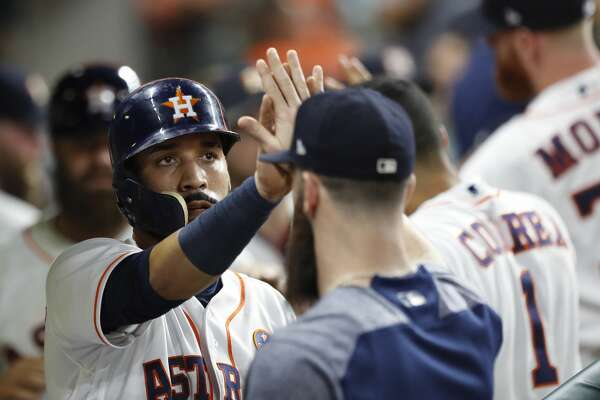 Houston Astros Marwin Gonzalez (9) celebrates his run scored on Yuli Gurriel's RBI double during the fourth inning of an MLB baseball game at Minute Maid Park, Wednesday, Sept. 20, 2017, in Houston.  ( Karen Warren / Houston Chronicle )