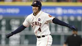 Houston Astros George Springer (4) reacts after Chicago White Sox left fielder Nicky Delmonico lept up to snag his fly out during the fifth inning of an MLB baseball game at Minute Maid Park, Wednesday, Sept. 20, 2017, in Houston.  ( Karen Warren / Houston Chronicle )