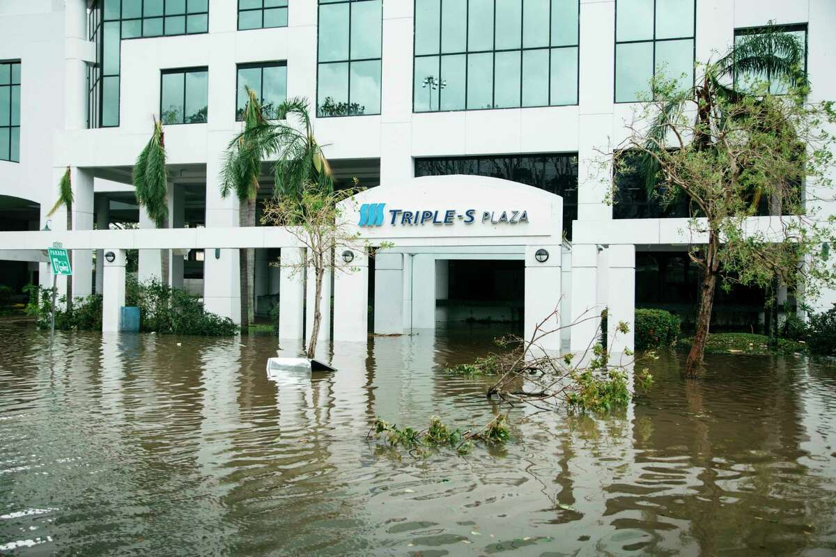 Floodwaters surround the entrance of the headquarters of Triple-S, a health insurance company, on Roosevelt Avenue in San Juan, P.R., Sept. 20, 2017. Hurricane Maria battered Puerto Rico as a Category 4 storm on Wednesday, sending thousands of people scrambling to shelters and knocking out power on the island. (Erika P. Rodriguez/The New York Times) ORG XMIT: XNYT168