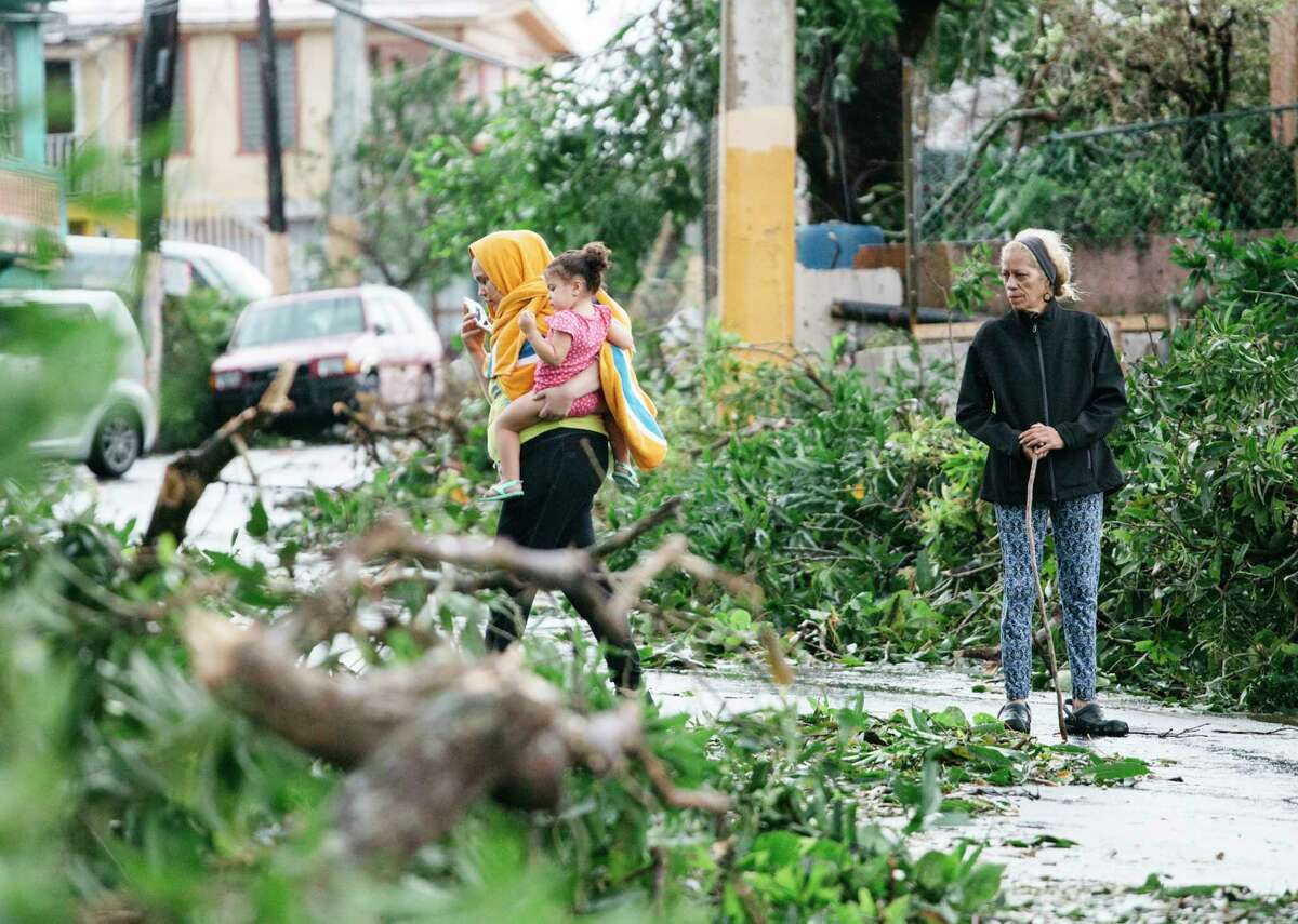 Rosa Torres, right, views the aftermath after Hurricane Maria in Guaynabo, P.R., Sept. 20, 2017. Hurricane Maria battered Puerto Rico as a Category 4 storm on Wednesday, sending thousands of people scrambling to shelters and knocking out power on the island. (Erika P. Rodriguez/The New York Times) ORG XMIT: XNYT170