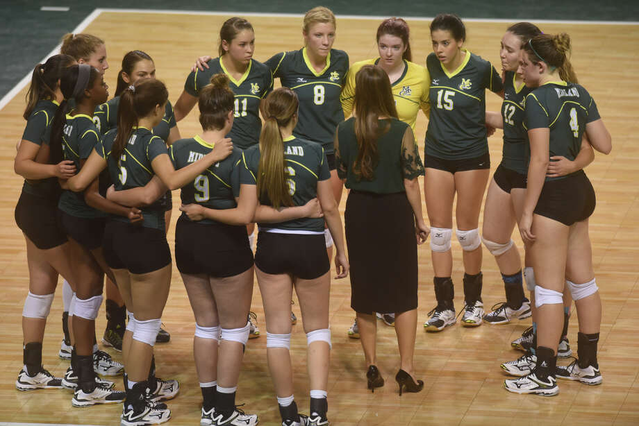 Midland College volleyball players huddle during the game against Odessa College on Sept. 20, 2017, at Chaparral Center.  James Durbin/Reporter-Telegram Photo: James Durbin