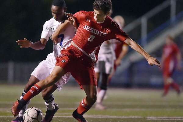 Fairfield Prep junior forward Axel Whamond battles West Haven's Matt French during this boys soccer game Wednesday. Whamond recorded a hat trick in a 5-0 win.