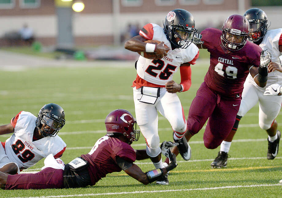 Central's Nathan Powell dives to try and stop Port Arthur Memorial's Elijah Hines, who runs past the Jaguars defense for the touchdown during their season openers at The Thomas Center Wednesday. Like many area schools, football season was delayed and mid-week games are being scheduled to help catch up on district play. Photo taken Wednesday, September 20, 2017 Kim Brent/The Enterprise Photo: Kim Brent / BEN