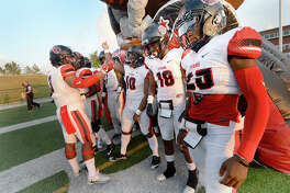 Port Arthur Memorial's variety get pumped up as they get ready to take the field against Central during their season openers at The Thomas Center Wednesday. Like many area schools, football season was delayed and mid-week games are being scheduled to help catch up on district play. Photo taken Wednesday, September 20, 2017 Kim Brent/The Enterprise