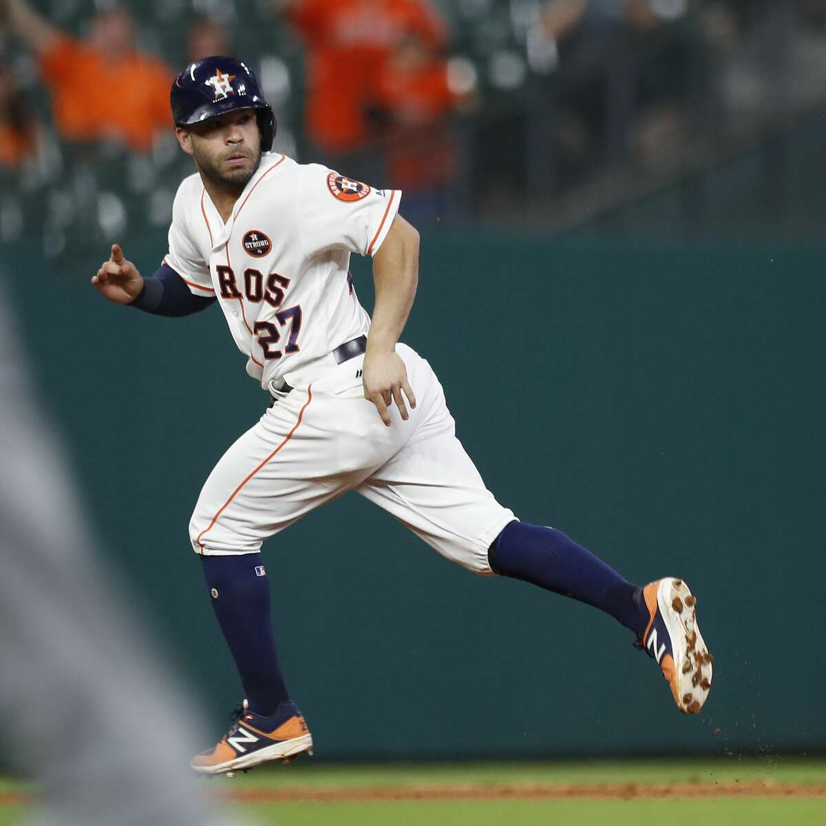 Houston Astros Jose Altuve (27) is nearly picked off of first base, but a throwing error allowed him to advance to third base during the seventh inning of an MLB baseball game at Minute Maid Park, Wednesday, Sept. 20, 2017, in Houston. ( Karen Warren / Houston Chronicle )