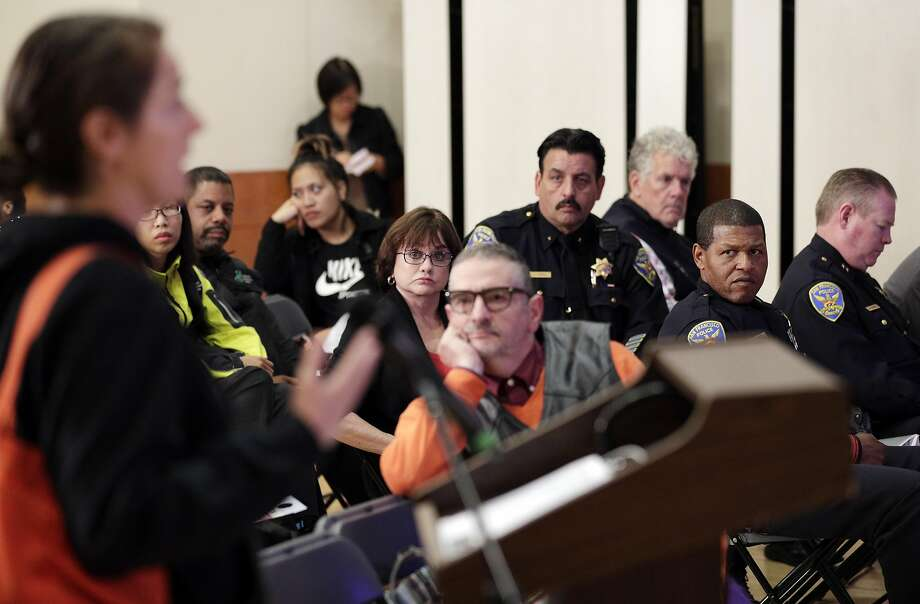 San Francisco Police command staff and residents listen as Anne Pantelick describes how she feels vehicle crime is not addressed sufficiently during a police commission meeting at Grace Cathedral. Photo: Carlos Avila Gonzalez, The Chronicle