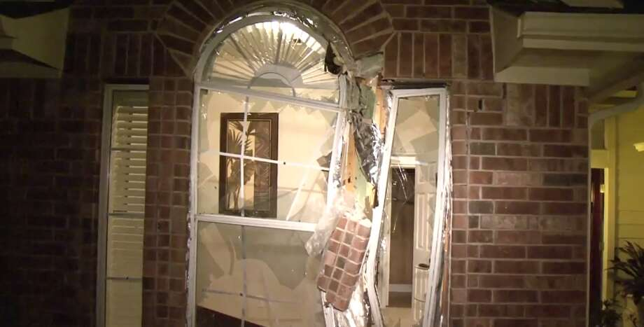 A possibly drunk driver hit the front of a northwest Harris County house late Wednesday, smashing a front window and sending furniture askew. (Metro Video) Photo: Metro Video