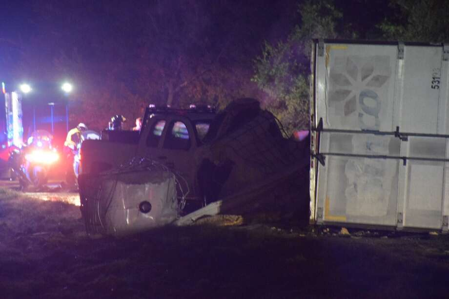 An 18-wheeler containing a flammable liquid rolled over Thursday morning in East Bexar County. Photo: Caleb Downs / San Antonio Express-News