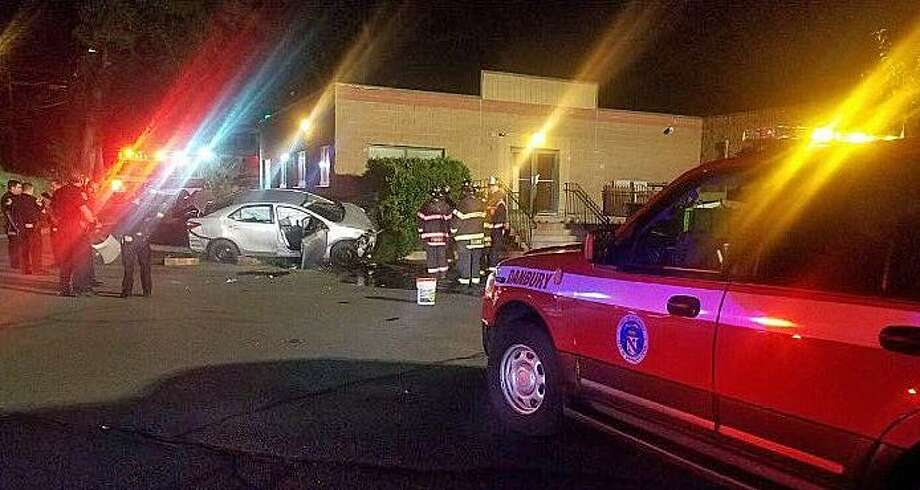 A driver was extricated from a vehicle Thursday morning on Sept. 21, 2017 after crashing into a a building on West Street. Photo: Danbury Fire Department