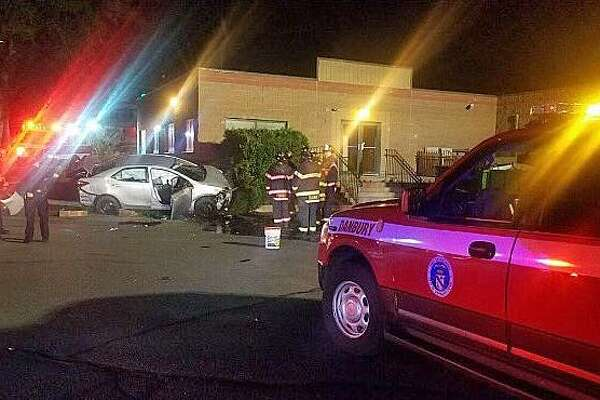 A driver was extricated from a vehicle Thursday morning on Sept. 21, 2017 after crashing into a a building on West Street.