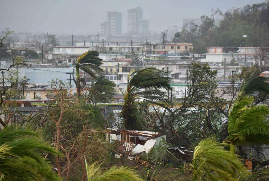 Destruction caused by Hurricane Maria close to Roberto Clemente Coliseum in San Juan, Puerto Rico, on September 20, 2017. Maria slammed into Puerto Rico on Wednesday, cutting power on most of the US territory as terrified residents hunkered down in the face of the island's worst storm in living memory. After leaving a deadly trail of destruction on a string of smaller Caribbean islands, Maria made landfall on Puerto Rico's southeast coast around daybreak, packing winds of around 150mph (240kph). Photo: Jose Romero/AFP/Getty Images / AFP/Getty Images / AFP or licensors