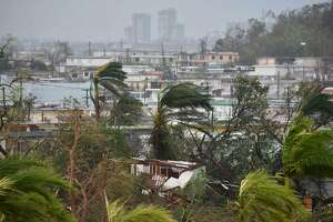 Destruction caused by Hurricane Maria close to Roberto Clemente Coliseum in San Juan, Puerto Rico, on September 20, 2017. Maria slammed into Puerto Rico on Wednesday, cutting power on most of the US territory as terrified residents hunkered down in the face of the island's worst storm in living memory. After leaving a deadly trail of destruction on a string of smaller Caribbean islands, Maria made landfall on Puerto Rico's southeast coast around daybreak, packing winds of around 150mph (240kph).