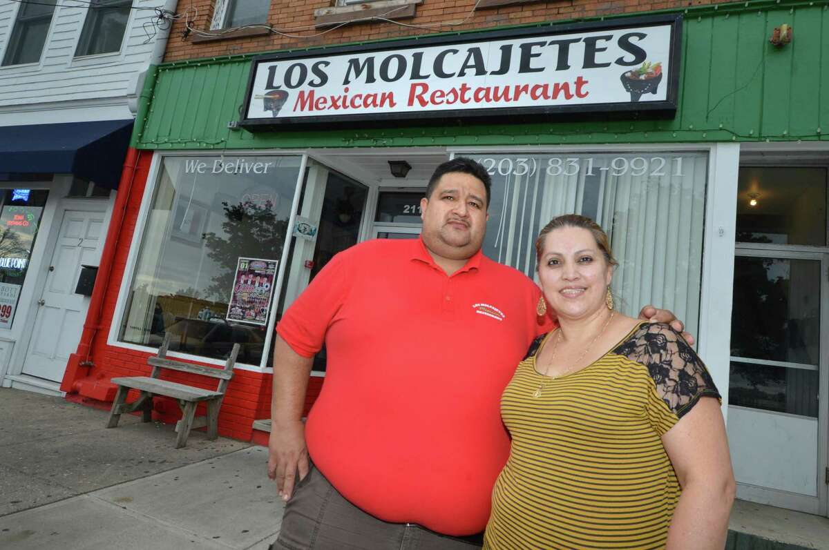 Carlos and Griselda Vargas stand in front of the restaurant they own, Los Molcajetes Mexican Restaurant, in Liberty Square in Norwalk in 2017.