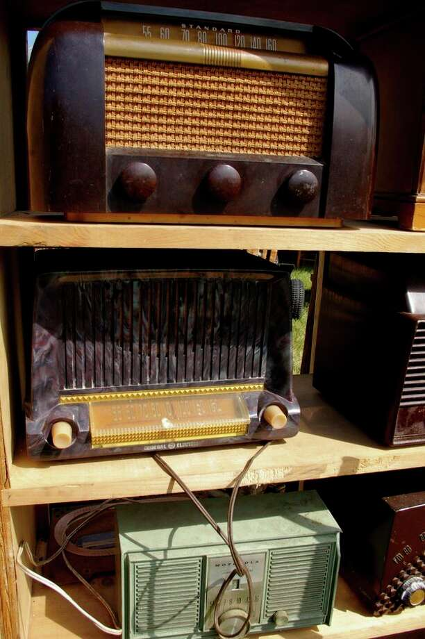 A stack of vintage radios at the 2012 Michigan Antique & Collectible Festivals at the Midland County Fairgrounds. (Daily News file photo)