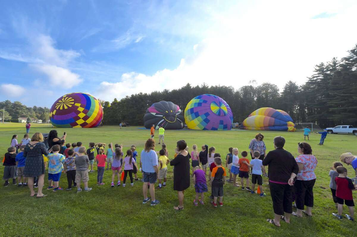 Hours before the 45th Adirondack Balloon Festival gets underway in Queensbury and Glens Falls, organizers visited Harrison Elementary School in South Glens Falls. Hours before the 45th Adirondack Balloon Festival gets underway in Queensbury and Glens Falls, organizers visited Harrison Elementary School in South Glens Falls. The balloon festival begins Thursday night and continues through Sunday.