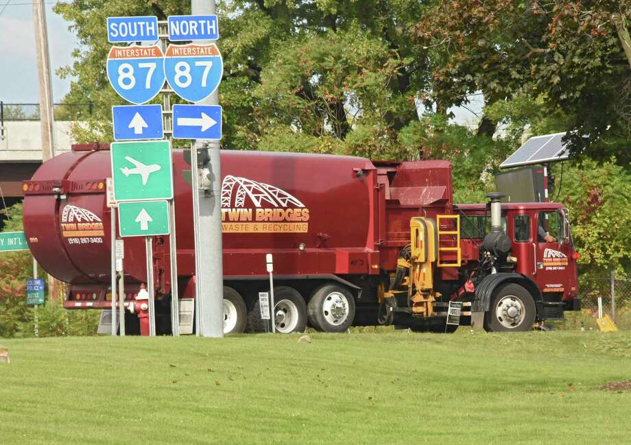 Joseph Puorro stands drives the Twin Bridges Waste and Recycling truck he drives on Wednesday, Sept. 20, 2017 in Colonie, N.Y. (Lori Van Buren / Times Union) Photo: Lori Van Buren, Albany Times Union