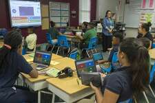 Angelica Yorkman's sixth grade ELA class utilize Chrome books 9/21/17 in class to answer questions during a lesson. Tim Fischer/Reporter-Telegram