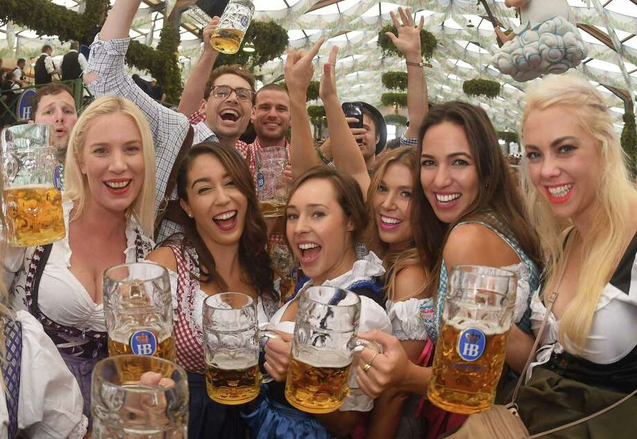 People drink the first mugs of beer after the official opening of the 184th Oktoberfest, Munich's annual beer festival, Sept. 16. Photo: Felix Horhager /AFP / Getty Images / DPA