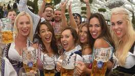People drink the first mugs of beer after the official opening of the 184th Oktoberfest, Munich's annual beer festival, Sept. 16.