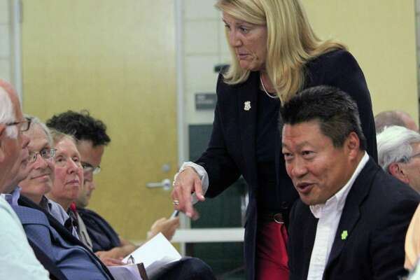 State Rep. Brenda Kupchick, R-132, and state Sen. Tony Hwang R-28, talk with residents before the start of a forum on affordable housing Monday. Fairfield,CT. 9/20/17