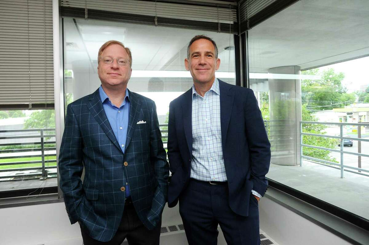MediaCrossing CEO Michael Kalman and Executive Vice President Lee Davis pose for a photo inside their West Broad Street office in downtown Stamford, Conn., on Tuesday, July 25, 2017.