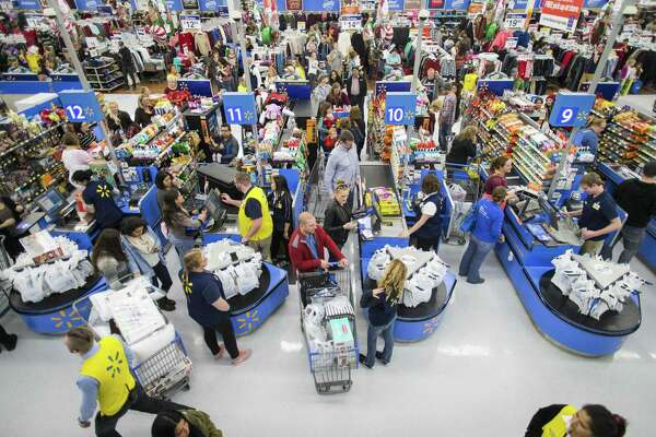 Black Friday shoppers in November 2016 at a Walmart store in Bentonville, Ark. For a second straight year, the retail giant does not plan on mass hiring of seasonal help for the holidays, instead awarding extra hours to existing employees. (Gunnar Rathbun/AP Images for Walmart)