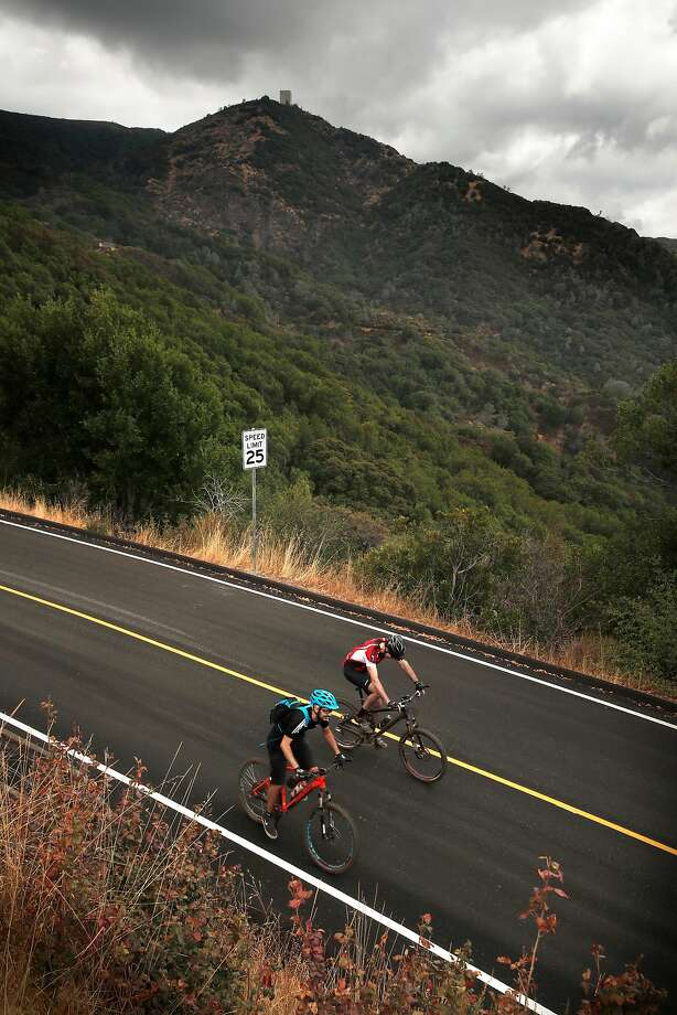 Bicycle riders on their desent from the summit of Mount Umunhum. Photo: Michael Macor, The Chronicle