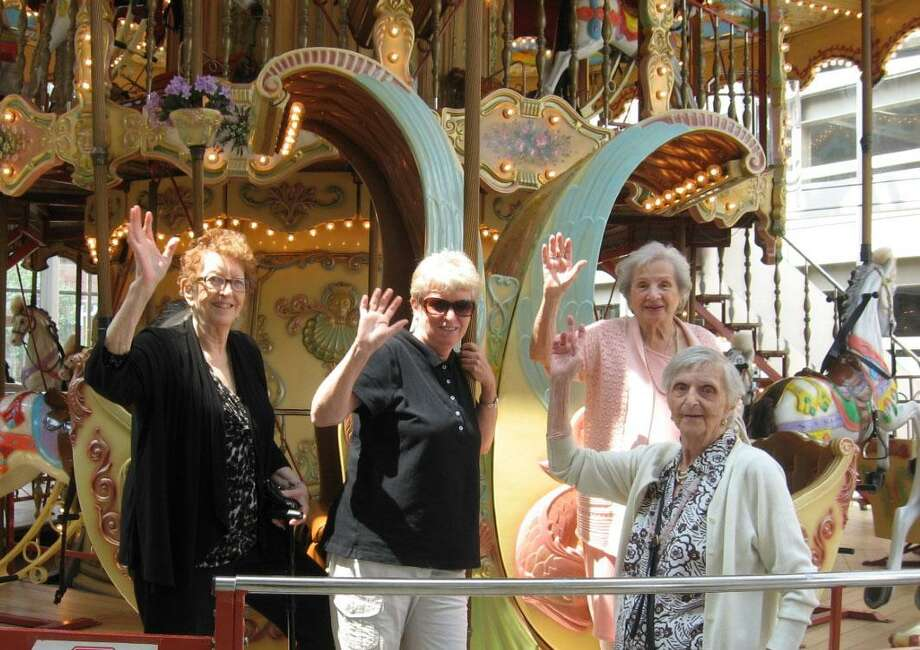 Several women from the Sherman Senior Center recently paid a visit to the Danbury Fair Mall. While there, bus driver Sue Moore, second from left, joined three ladies, from left to right, Doreen Branch, Madeline DeMayo, 92, and Nelda Scheremata, 96, for a ride on the malls historic carousel. Photo: Courtesy Of Jodi Bogus / The News-Times Contributed