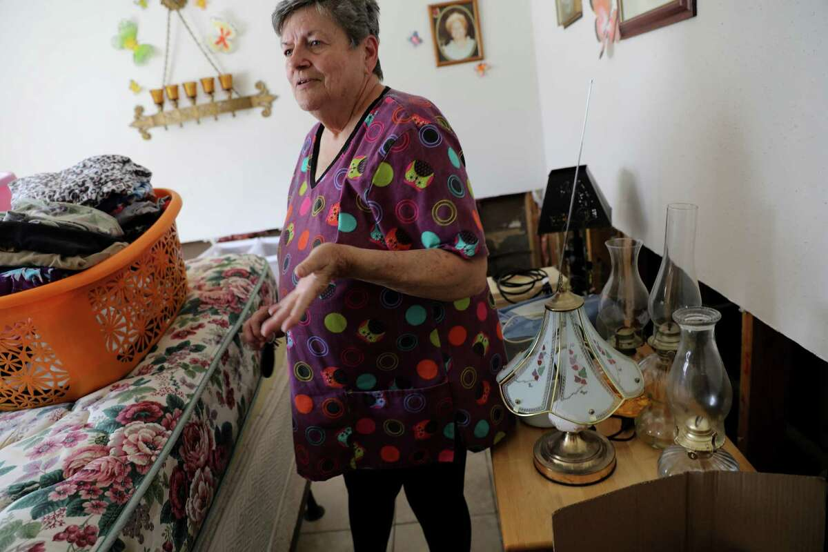 Sherry Abegzel walks through her apartment at Travis Villas in Liberty, Texas on Tuesday, Sept. 19, 2017. The National Weather Service estimates that Liberty County received more than 54 inches of rain when Harvey lashed the region late last month( Elizabeth Conley / Houston Chronicle )