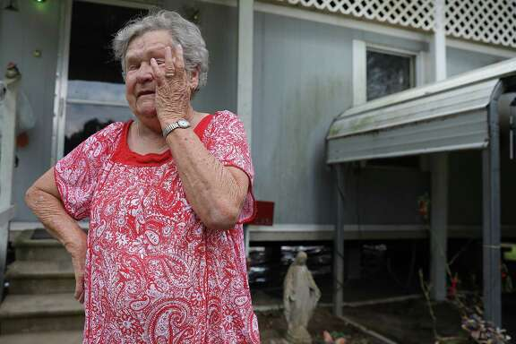 """Linda Satsky wipes tears away from her eyes as she talks about getting rejected from FEMA for assistance. """"I live on Social Security, I don't have extra money,"""" said Satsky. Residents in Liberty, Texas talk about dealing the with aftermath of Hurriane Harvey onTuesday, Sept. 19, 2017. The National Weather Service estimates that Liberty County received more than 54 inches of rain when Harvey lashed the region late last month( Elizabeth Conley / Houston Chronicle )"""