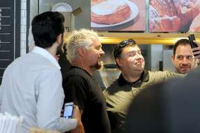"""Food Network star Guy Fieri strolled through downtown San Antonio with a film crew last June, including a stop at La Panadería, where an episode of """"Diners, Drive-Ins, and Dives"""" was taped. The episode airs on Friday at 8 p.m."""