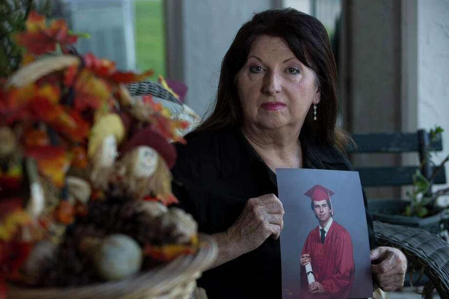 Evelyn Kelly poses for a portrait with her son Chris Dunn's photogrph at her portch Friday, Sept. 15, 2017, in Pasadena. Kelly's lawsuit challenging the constitutionality of Texas' futile-care law is scheduled to be heard Sept. 22. She filed the suit after the death of her son, for whom Houston Methodist invoked the law, which allows hospitals to withdraw life support if they think treatment is futile.( Yi-Chin Lee / Houston Chronicle ) Photo: Yi-Chin Lee, Staff / © 2017  Houston Chronicle