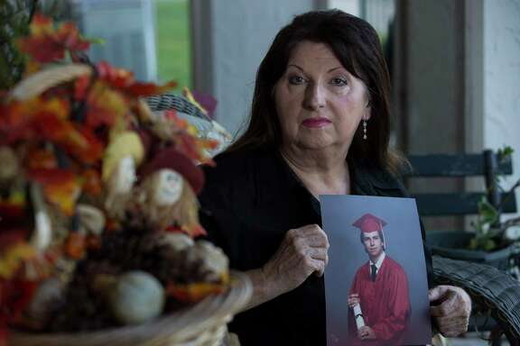 Evelyn Kelly poses for a portrait with her son Chris Dunn's photogrph at her portch Friday, Sept. 15, 2017, in Pasadena. Kelly's lawsuit challenging the constitutionality of Texas' futile-care law is scheduled to be heard Sept. 22. She filed the suit after the death of her son, for whom Houston Methodist invoked the law, which allows hospitals to withdraw life support if they think treatment is futile.( Yi-Chin Lee / Houston Chronicle )