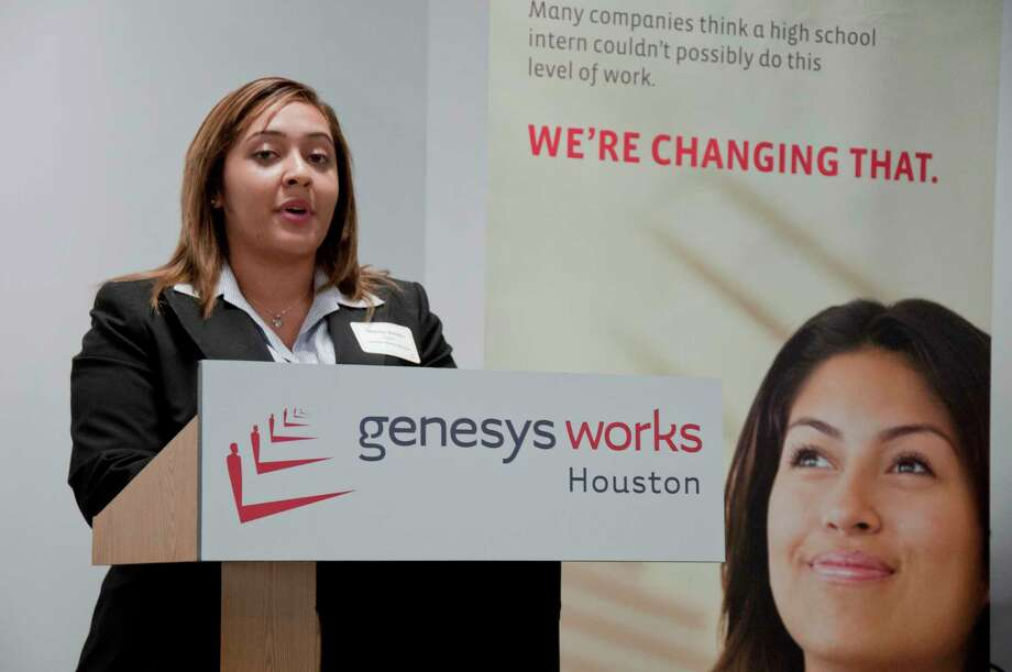 Marilyn Bonilla giving a speech about the impact in her life of the Genesys Works educational program for high school students in Houston in November 2013. Photo: Olivia P. Tallet, La Voz / La Voz / Houston Chronicle