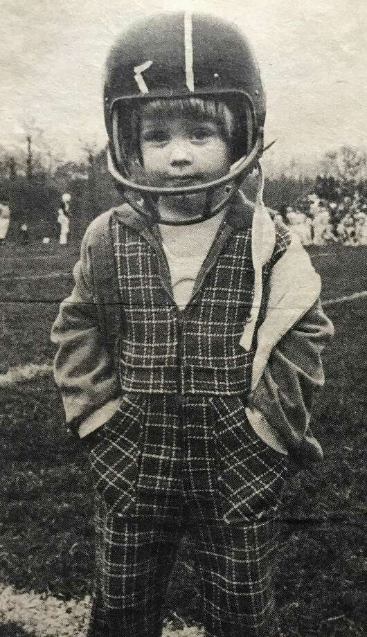 Staff writer Scott Ericson, at 2-years old at a Darien High football game. Photo: Contributed Photo / Stamford Advocate Contributed