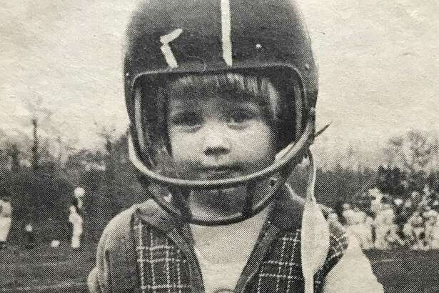 Staff writer Scott Ericson, at 2-years old at a Darien High football game.