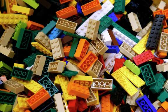 An assortment of building blocks are displayed in a bin in the new Lego store at Westfield SF Centre shopping mall in San Francisco, Calif. on Aug. 26, 2016.