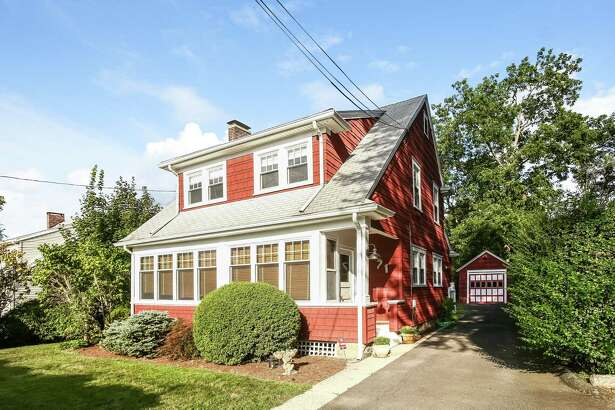 The three-bedroom, two-bathroom cape at 71 Belltown Road is listed at $509,000. The home has vintage charm with an updated kitchen and full bathroom.