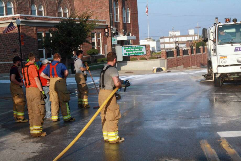 Crews spent roughly 12 hours on Wednesday cleaning up a chemical spill at the intersection of State Street and M-25 in downtown Harbor Beach. The chemical did not enter the city's drain system and was not a harm to the public. Photo: Rich Harp/For The Tribune