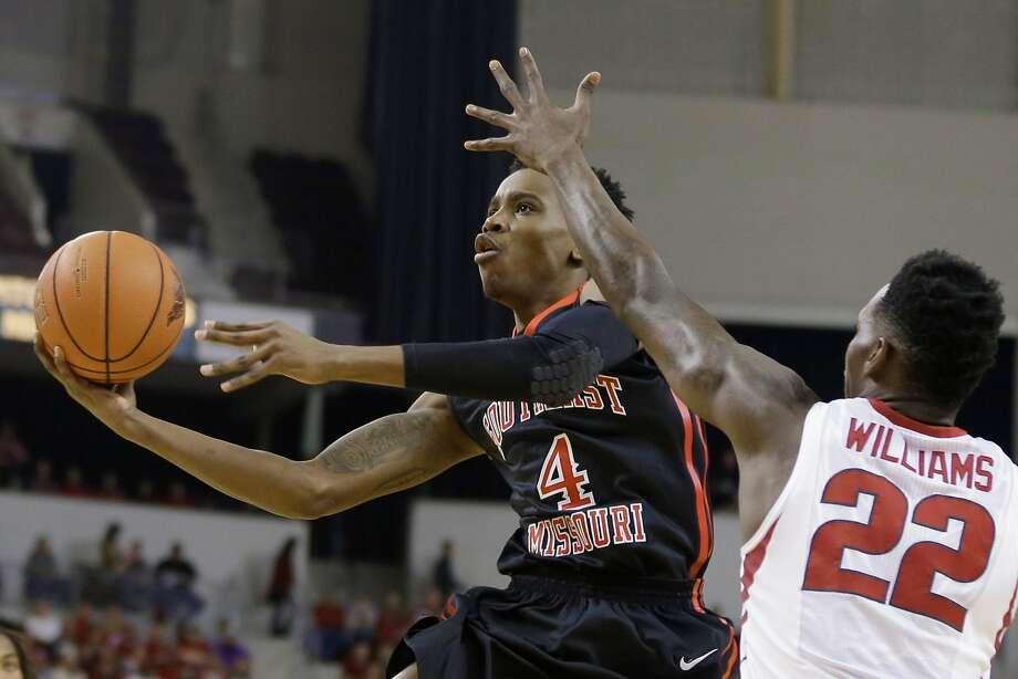 Southeast Missouri State's Antonius Cleveland (4) goes to the basket in front of Arkansas's Jacorey Williams (22) is first half of an NCAA college basketball game in North Little Rock, Ark., Saturday, Dec. 20, 2014. (AP Photo/Danny Johnston) Photo: Danny Johnston, Associated Press