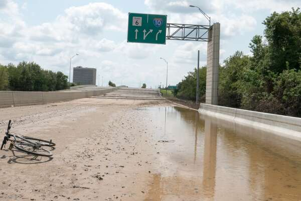 """Highway 6 closure north of the Katy Freeway- Reminds me of a Walking Dead image. Hurricane Harvey mud in the foreground, with Interstate 10 in the distance. Highway 6 is blocked at I-10 for northbound traffic.""   @camerawelltraveled"