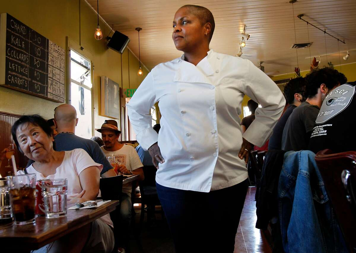 Tanya Holland, the owner of Brown Sugar Kitchen, a popular gathering place on Mandela Parkway, pauses as she works Sunday October 12, 2014 in Oakland, Calif. Twenty-five years after the Loma Prieta earthquake toppled the Cypress freeway and killed over 40 people in West Oakland, the community is seeing new life and energy.