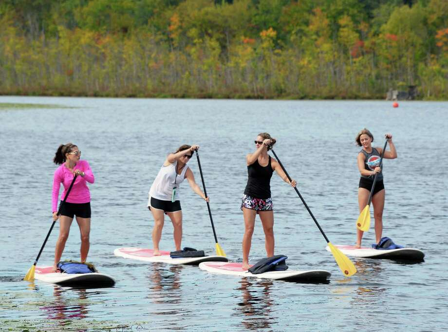 Paddle boarders, from left, Mary Querbes of Wilton, Kim Stein of Wilton, Lindsay Ferrara of Wilton and Stephanie Phillips of Saratoga Springs, enjoy the last days of summer with an outing on Fish Creek Wednesday Sept. 201, 2017 in Saratoga Springs, NY.  (John Carl D'Annibale / Times Union) Photo: John Carl D'Annibale, Albany Times Union