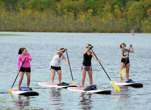 Paddle boarders, from left, Mary Querbes of Wilton, Kim Stein of Wilton, Lindsay Ferrara of Wilton and Stephanie Phillips of Saratoga Springs, enjoy the last days of summer with an outing on Fish Creek Wednesday Sept. 201, 2017 in Saratoga Springs, NY.  (John Carl D'Annibale / Times Union)